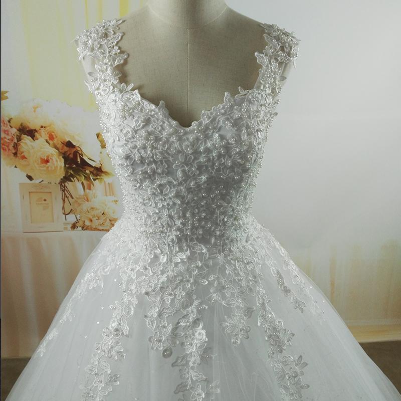e0257d4c1317 Svadobné šaty s perlami a šifónom